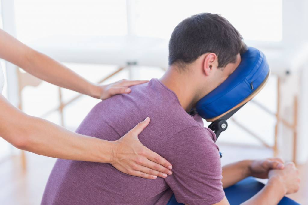 38349017 - man having back massage in medical office